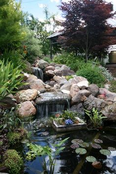 Landscaping And Outdoor Building , Relaxing Waterfalls Backyard Ponds : Waterfalls Backyard Ponds With Container Plant