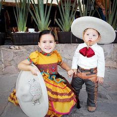 :) charro y escaramuza ~ que bella parejita. All children are beautiful but we especially enjoy the Mexican children wearing traditional clothing - for more of Mexico visit www. Mexican Outfit, Mexican Dresses, Mexican Style, Mexican Rodeo, Mexican Clothing, Mexican Birthday, Mexican Party, Charro Wedding, Mariachi Wedding