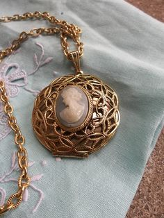 #Vintage Cameo Locket Pendant Necklace Costume Jewelry Gold Locket Theater Play Prop Supplies Altered Art. $7.50, via Etsy.