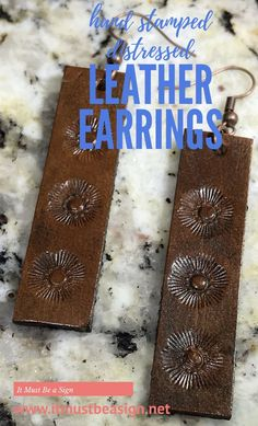 Handmade, hand stamped, dyed and distressed with a multi step process, genuine leather earrings.