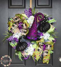 A personal favorite from my Etsy shop https://www.etsy.com/listing/526152574/halloween-wreath-floral-halloween-wreath