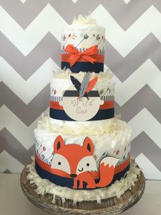 Wild One Tribal Diaper Cake in Orange, Navy and Gray, Tribal Baby Shower Centerpiece by AllDiaperCakes on Etsy https://www.etsy.com/listing/477572512/wild-one-tribal-diaper-cake-in-orange