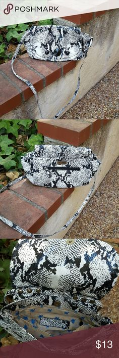 Black and white faux snakeskin crossbody bag Gently used black and white bag. Snaps closed, multiple pockets on the inside. One zipper pocket on the back. Smoke free. No stains. Super cute and a perfect size for travel! libby. edelman Bags Crossbody Bags