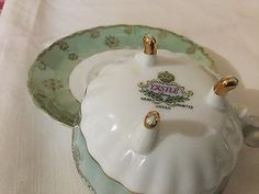 CASTLE HAND PAINTED 3 LEGGED CUP AND SAUCER. JAPAN