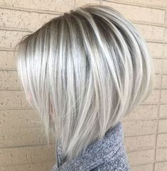 "The dark gray roots and the silvery-white ""top coat"" emphasize the angles of the inverted bob cut. When you're thinking about hairstyles for fine hair, we suggest a rounded and stacked shape. The slightly longer pieces in the front generate the desired dynamics for the hair that tends to lay flat."