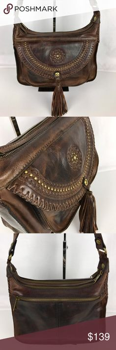 """Patricia Nash Distressed Leather Camila Crossbody Condition: Gently Used - Distressed leather - good condition inside and out.  Cast in distressed Italian leather with of-the-moment Western tooled detail, this roomy, double-compartment crossbody from Patricia Nash hangs right at your hip and keeps daily essentials handy in an easy-access front organizer pocket. 11-3/4""""W x 7-1/2""""H x 3-1/2""""D. 23""""-26""""L adjustable crossbody strap. Style P04606. Our bag #RB158  Thank you for your interest! No…"""