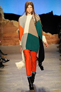 Great color-blocking. I especially like the orange pants with the boots and socks. (Band of Outsiders)