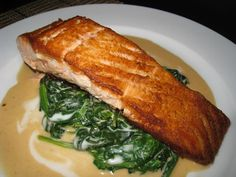 Seared Salmon on Thai Curried Spinach Pan Seared Salmon on Thai Curried Spinach. Not a great photo, but the recipe sounds delicious.Pan Seared Salmon on Thai Curried Spinach. Not a great photo, but the recipe sounds delicious. Copycat Recipes, Fish Recipes, Seafood Recipes, Cooking Recipes, Healthy Recipes, Thai Recipes, Seared Salmon Recipes, Pan Seared Salmon, Cooking With White Wine