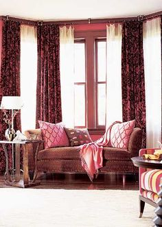Might be a good way to help with the light problem in the living room? - double layer curtains for bay    Window treatment for a bay window-  Dress a bay window niche with two layers of fabric for the most flexibility. Sheers pull across to cut the glare and increase privacy, while patterned velvet panels add the color, softness, and style the room demands.