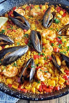 Authentic Spanish Seafood Paella Recipe - Spain on a Fork - - This Authentic Spanish Seafood Paella Recipe is loaded with flavor and easier to make than you think. Surprise yourself and your guest with this seafood paella recipe from Valencia, Spain. Best Seafood Recipes, Fish Recipes, Sauce Recipes, Spanish Seafood Paella, Seafood Paella Recipe, Best Paella Recipe, Spain Paella Recipe, Authentic Spanish Paella Recipe, Seafood Boil
