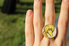 I attached the Big Bird coin to a blank ring I had from an old jewellery making kit.