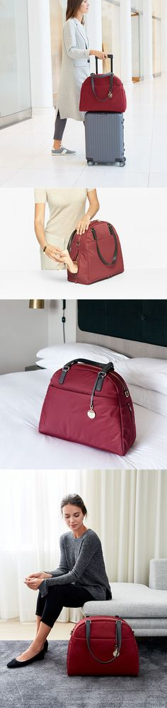 """A functional and lightweight carry-all made of from high-quality material for the modern traveler featuring a side pocket to store your shoes or umbrella. Designed to fit up to a 13"""" laptop in the padded laptop compartment and optimize your organization with a pocket for your tablet, work documents, a zipper pocket, and two slip pockets."""