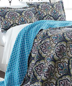 Our new bedspread has purple, navy, white, teal, and yellow in it. Our room will have to work with that crazy choice! #comforter #masterbedroom #quilt #zulily