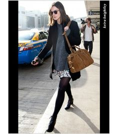 Keira Knightley: loose grey sweater peeking out under black blazer, floral skirt, black opaque tights and ankle booties
