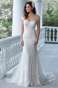 Wedding gown by Sincerity Bridal.