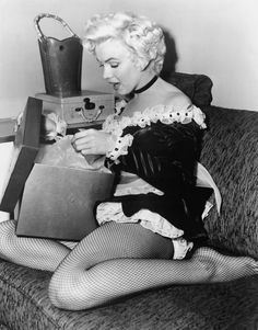 12th Day of Christmas-Marilyn Monroe happily opening her present.