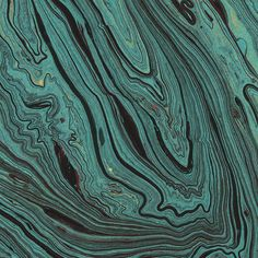 Freeform marbled papers with delicate veining similar to the organic patterns found in polished agate and other gemstones. These sheets are certified Fair Trade. The 20