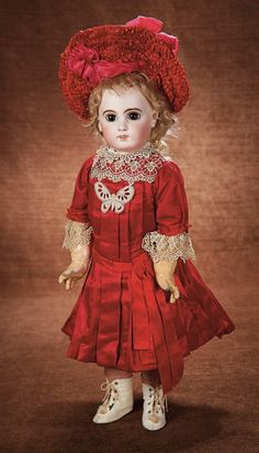 At Play in a Field of Dolls Saturday, October 04, 2014  |  11:00 AM Pacific Beautiful French Bisque E.J. Bebe by Emile Jumeau in Superb Costume 5500/7500
