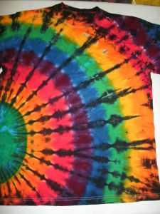 Sep 2016 - Heather models a Rainbow Spiral Black Over Dye by Up and Dyed One of the most enduring color combinations that I have marketed over the years is the Rainbow spectrum with a black over dye spiral, a… Tie Dye Tutorial, How To Tie Dye, How To Dye Fabric, Dyeing Fabric, Shibori, Rainbow Fan, Tie Dye Party, Tie Dye Kit, Tie Dye Crafts