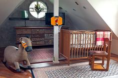 The nursery is furnished with a simple wooden crib, an old-fashioned rocking horse, and an antique cabinet.  See more photos and view the full home here: http://www.realliving.com.ph/homes/eclectic-filipino-design-reigns-in-this-family-home
