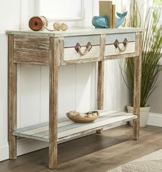A Sea inspired Collection of Console Tables... http://www.completely-coastal.com/2017/04/coastal-console-tables.html Weathered console tables with rope handles, blue console tables, and coastal theme console tables.