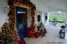 Rocking chairs & front porch decorated for Christmas: http://www.front-porch-ideas-and-more.com/elegant-christmas-decorating-ideas.html