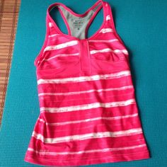 """Selling this """"Padded XS Nike Dri-fit tank in excellent condition"""" in my Poshmark closet! My username is: tinovia. #shopmycloset #poshmark #fashion #shopping #style #forsale #Nike #Tops"""