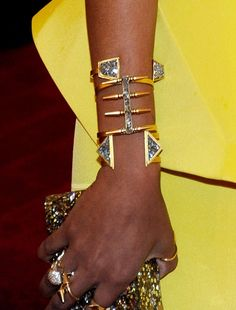 Geometric Glamour  Lady GreySymtra Bangle($239),Spike Channel Cuff($300), andReflected Triangle Cuff($254); Jennifer Fisher Twisted Cone Ring ($250) Solange Knowles