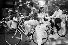 so lovely! This newlywed couple riding through the streets of Thailand, photo by Julian Wainwright of Wainwright Weddings, South Asia destination wedding photographer | via junebugweddings.com