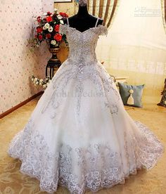 590e46fc42c9 Wholesale 2013 A Line SWAROVSKI Luxury Crystals Beades White Cathedral  Train Lace Bridal Gown Wedding Dress