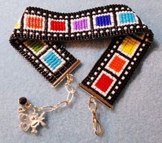 Vibrant rainbow color block bracelet made from nice flat Delica seed beads, looks like movie film. It is 3/4 inch wide and 6-3/4 inches long, and with the chain/clasp adjusts up to over 8 inches. C…