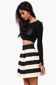 Skirt is adorable. I wouldn't wear it with a crop top tho...