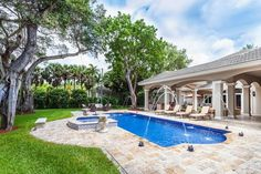 Soak in the sun in this gorgeous blue tiled pool. #EWMRealty #Pinecrest