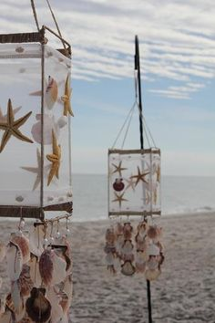 Shell chimes on hooks for a beach wedding. These would be pretty with twinkle lights inside.