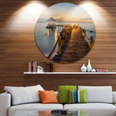 Designart 'Brown Wooden Pier in Evening' Seashore Photo Round Wall Art