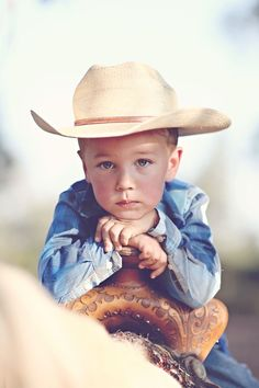 Little boy posing in a cowboy hat.