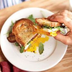 Toasted Breakfast Sandwich...for a healthier option use multi-grain bread, low-fat cheddar, olive oil instead of vegetable oil, egg whites, and turkey bacon
