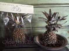 Hand dried pineapples by Me...Olde Pear Primitives. Comes complete with rosehips. Just add bowl. Pineapples may shrink some more over time, but will still retain shape. Each pineapple is different and color and shape may vary. Size is about 9 inches from bottom of pineapple to top of leaves.