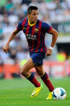 Alexis Sanchez of FC Barcelona runs with the ball during the La Liga match between Elche FC and FC Barcelona at Estadio Manuel Martinez Valero on May 11, 2014 in Elche, Spain.