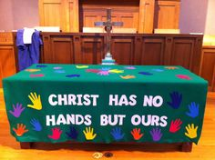"""Children's Sabbath communion cloth, using handprints of our Sunday School children.  Words adapted from St. Teresa of Avila, """"Christ has no body now on earth but yours; no hands but yours; no feet but yours. Yours are the eyes through which the compassion of Christ must look out on the world. Yours are the feet with which He is to go about doing good. Yours are the hands with which He is to bless His people."""""""