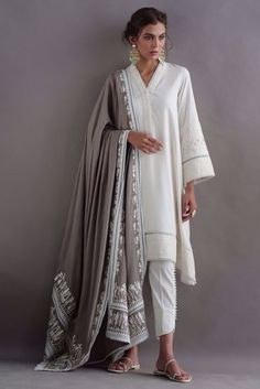 Fall linen drop kurta with pleating and delicate delicate detailing. Our beige pashmina mitla shawl is adorned with delicate leather work and can be worn in multiple ways. Comes with pants. Pakistani Dress Design, Pakistani Outfits, Indian Outfits, Pakistani Clothing, Pakistani Bridal, Dress Indian Style, Indian Dresses, Indian Wear, Kurti Designs Party Wear