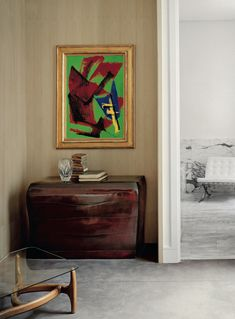 Interior design by Pierre Yovanovitch; wooden chest by Gérard Schneider (1970) below a Jacques Jarrige painting (1980). © Philippe Garcia