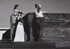 Frida-Kahlo and Diego Rivera-by-Lucienne-Bloch looking at solar eclipse in Detroit, Michigan 1932.