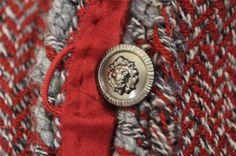 Chanel. Interesting button closure.