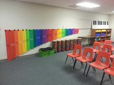Put velcro on boomwhackers and a velcro strip on the wall. Decorative and easy to use storage!