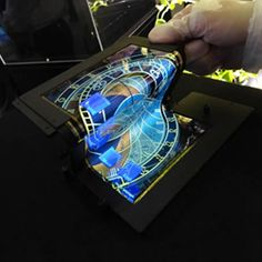 Foldable Phones and Tablets Are Around the Corner | Japanese company Semiconductor Energy Laboratory demonstrated a display that can be folded in thirds.