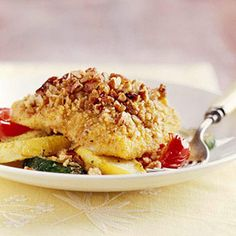 Pecan Crusted Fish with Peppers and Squash - catfish fillets - white fish or orange roughy - yellow cornmeal - pecans - flour - cayenne pepper - egg - red or orange sweet peppers - zucchini - yellow squash