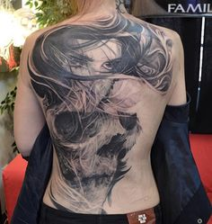 Girl and skull tattoo on back for woman - 100 Awesome Skull Tattoo Designs