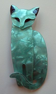 "An example of Lea Stein's Art Deco jewellery. This poised cat brooch is called ""Quarrelsome."""