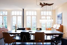 Sherylleysner   Interior Architecture & Project Management   Private house   Utrecht   Dining room   Concrete floor   Vintage chairs   Ruwe Bolster lamp   Piano  